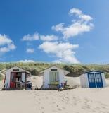 Tre kabiner på stranden Royaltyfria Bilder