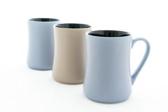Tre keramiska kopp med handtaget Arkivbilder