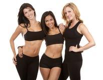 Tre konditionkvinnor Fotografering för Bildbyråer