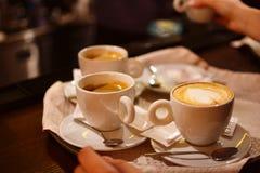 Tre koppar av ett varmt aromkaffe Fotografering för Bildbyråer