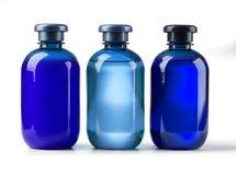 Tre kosmetiska flaskor Royaltyfri Foto