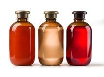 Tre kosmetiska flaskor Royaltyfria Foton
