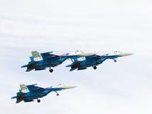 Tre kraftig militär Su-27 Fotografering för Bildbyråer