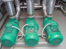 Tre kraftiga pumpar Fotografering för Bildbyråer
