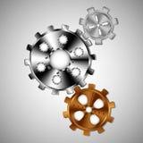 Tre kugghjul av olika format Arkivfoto