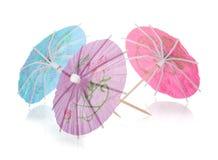Tre kulöra coctailparaplyer Arkivfoto