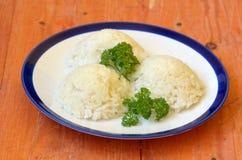 Tre kullar av lagade mat ris med lockig persilja fotografering för bildbyråer