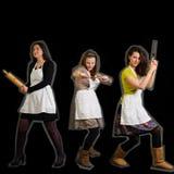 Tre kvinnliga kockar Arkivfoton