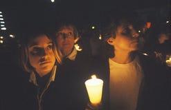 Tre kvinnor med stearinljuset, kvinnor för sinande bosniskt krig Arkivfoto