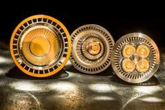 Tre lampadine del LED GU10 con le varie lenti divergenti di plastica Fotografie Stock
