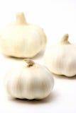 Tre lampadine dell'aglio. Immagini Stock