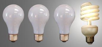 Tre lampadine e un fluorescente Fotografia Stock