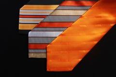Tre legami arancio Immagini Stock