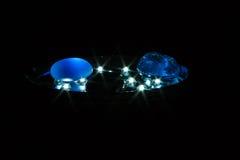 Tre lilla stycke av exponeringsglas på lampan Arkivfoton