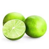 Tre limefrukter som skivas som isoleras på vit Arkivbilder