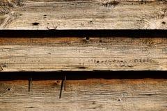 Tre linje gammal träbakgrund med spikar royaltyfri fotografi