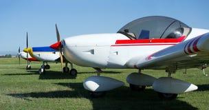 Tre ljusa flygplan Fotografering för Bildbyråer