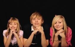 Tre lyckliga barn Arkivbild