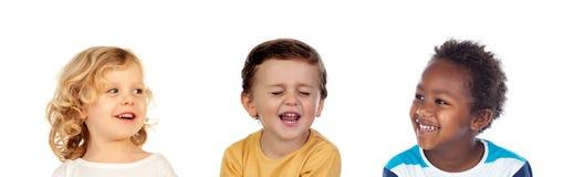 Tre lyckliga barn som gör skämt Royaltyfria Foton