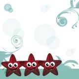 Tre lyckliga sjöstjärnor Arkivfoton