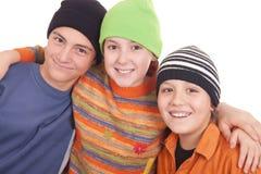 Tre lyckliga tonåringar Arkivbilder