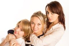 Tre lyckliga tonårs- flickavänner Royaltyfria Foton