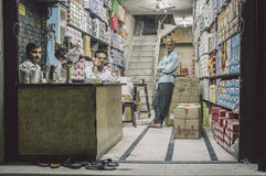Tre män i lager Fotografering för Bildbyråer