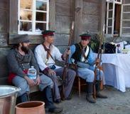 Tre män i ryssnybyggare c Royaltyfri Fotografi