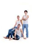 Tre män på en vit bakgrund i studio arkivfoton