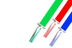 Tre mång--färgade rakknivar lämnar kulöra fläckar fotografering för bildbyråer