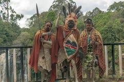 Tre Maasai med hans målade framsida Royaltyfri Foto