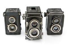 Tre macchina fotografica della foto dell'obiettivo dell'annata due Immagine Stock