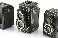 Tre macchine fotografiche della foto dell'obiettivo dell'annata due fotografia stock libera da diritti