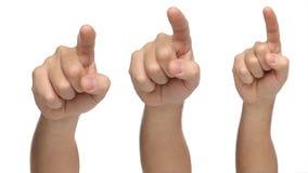 Tre mani che indicano o che toccano qualcosa Immagine Stock Libera da Diritti