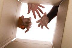 Tre mani che provano a raggiungere il soddisfare fotografia stock libera da diritti
