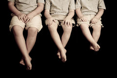 Tre mani e piedi dei bambini Fotografia Stock