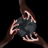 Tre mani intorno a terra binaria Fotografia Stock