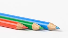 Tre matite immagine stock