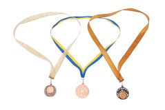 Tre medaglie di bronzo su bianco Fotografia Stock Libera da Diritti