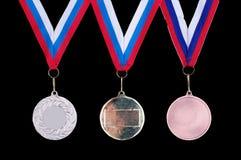 Tre medaljer, guld, silver och brons Fotografering för Bildbyråer