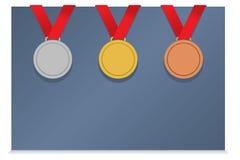 Tre medaljer på tomt kort Arkivbilder