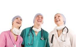 Tre medici sorridenti immagine stock