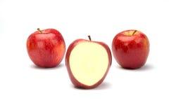Tre mele e un taglio Fotografie Stock
