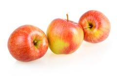 Tre mele rosse mature isolate Immagini Stock Libere da Diritti