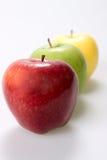 Tre mele su priorità bassa bianca Immagine Stock