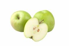Tre mele verdi una tagliate Immagini Stock Libere da Diritti