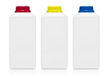 Tre mjölkar flaskan på vit bakgrund royaltyfri bild