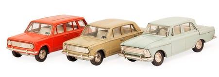 Tre modelli dell'automobile del giocattolo dei bambini Fotografia Stock