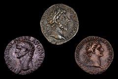 Tre monete romane antiche Immagini Stock