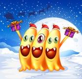 Tre monster som firar jul Royaltyfri Bild